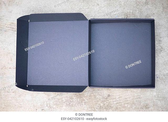 Opened black box with lid, top view