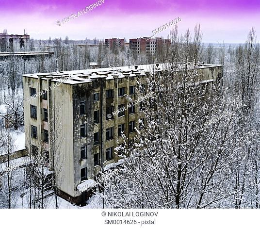 Horizontal pink radioactive industrial winter sunset near Pripyat background backdrop