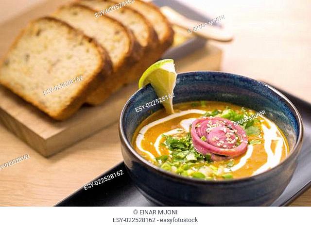 Bowl with soup and lemon slice