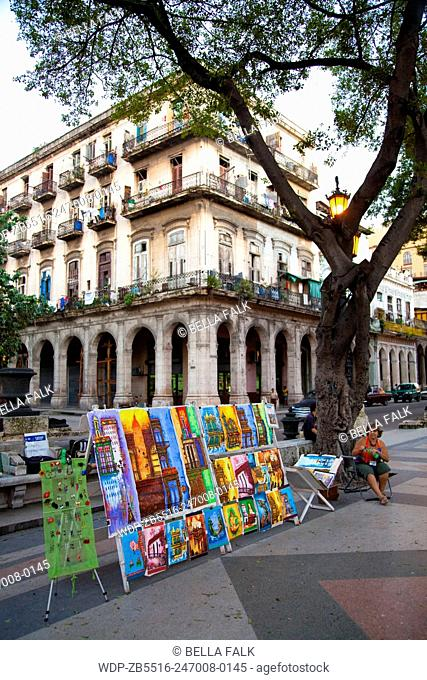 Colourful paintings in front of the buildings they represent, Havana, Cuba