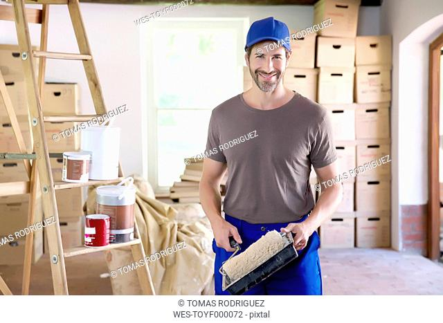 Man moving house, painting rooms