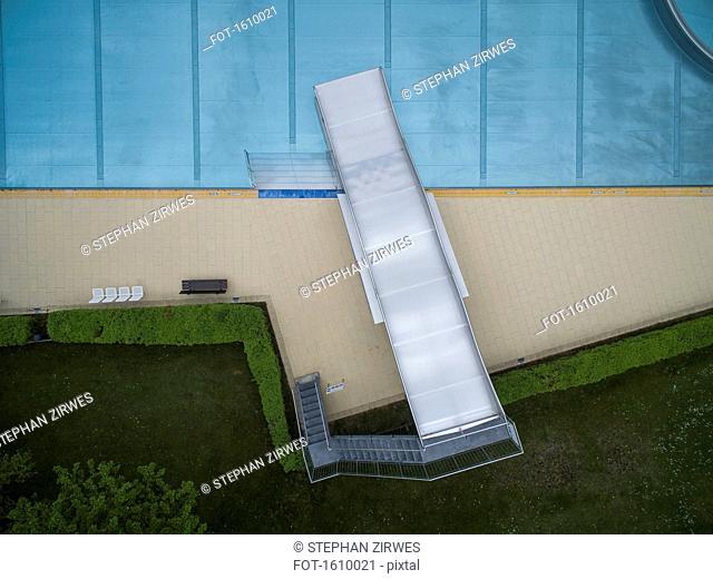 Directly above view of metal slide by pool, Sindelfingen, Baden-Wuerttemberg, Germany