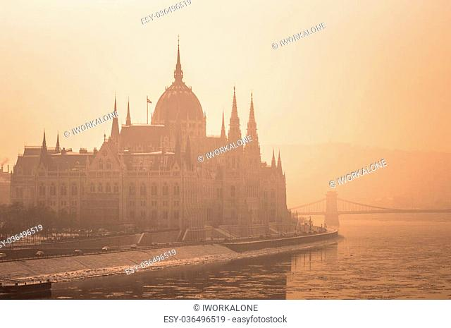 The hungarian parliament in fog at dusk