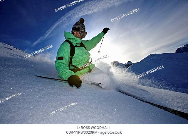 Skier turning off piste