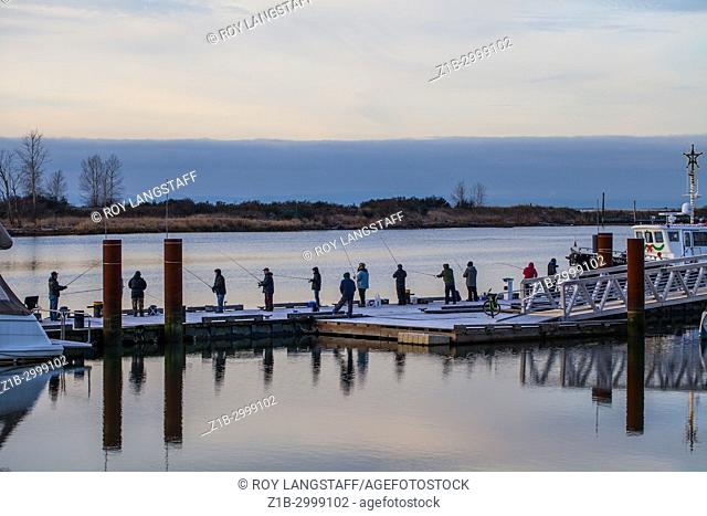Cold New Year's morning 2018 with people fishing in the Fraser River at Steveston