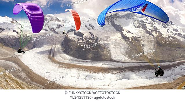 Paragliders over the Gornergletscher glacier viewed from Gornergrat. Zermatt