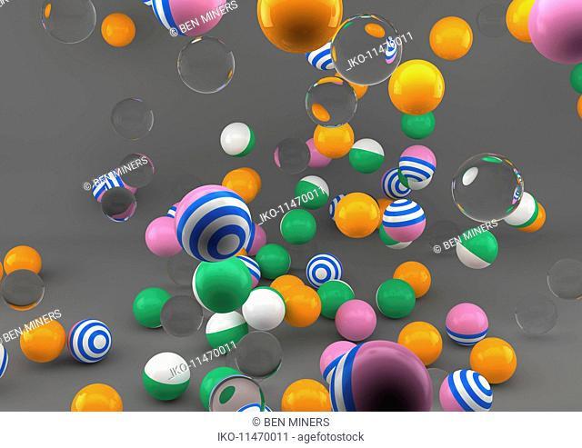 Colorful balls falling onto floor