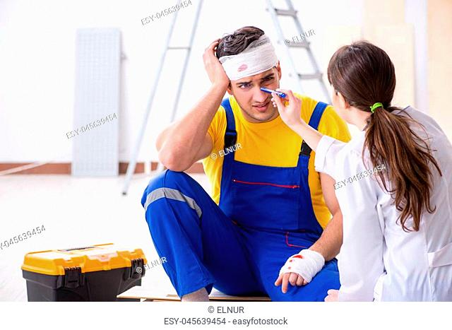 Worker with injured head and doctor