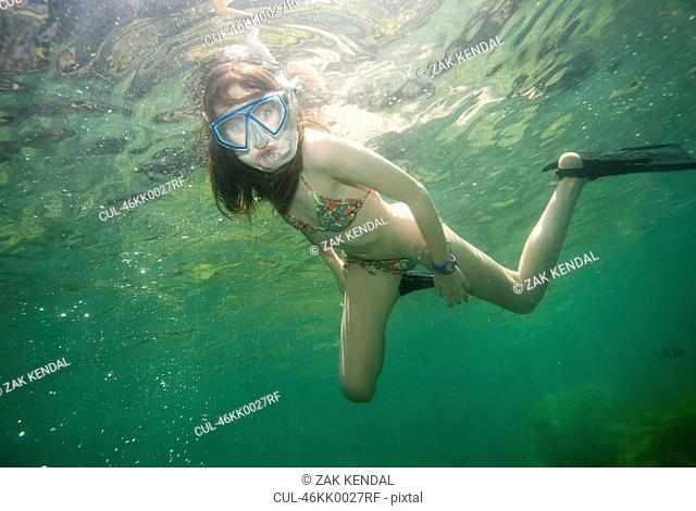 Girl snorkeling in tropical waters