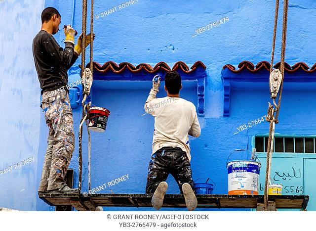 Local Men Paint The Outside Of A House In Traditional Blue, The Medina, Chefchaouen, Morocco