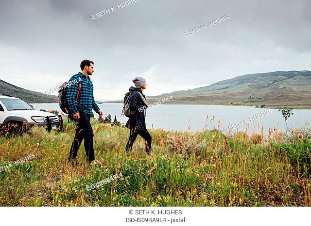 Couple walking beside Dillon Reservoir, Silverthorne, Colorado, USA