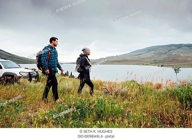 Couple walking beside Dillon Reservoir, Silverthorne, Colorado, USA