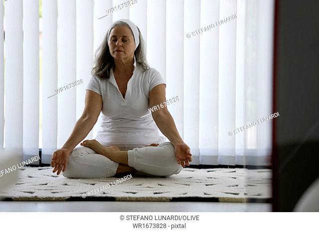 Mature woman doing yoga