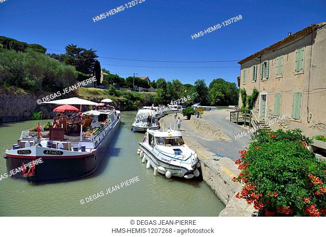 France, Herault, Beziers, Canal du Midi listed as World Heritage by UNESCO, locks of Fonseranes, tourist barge in the entrance of the upper airlock