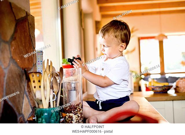 Little boy is playing in kitchen