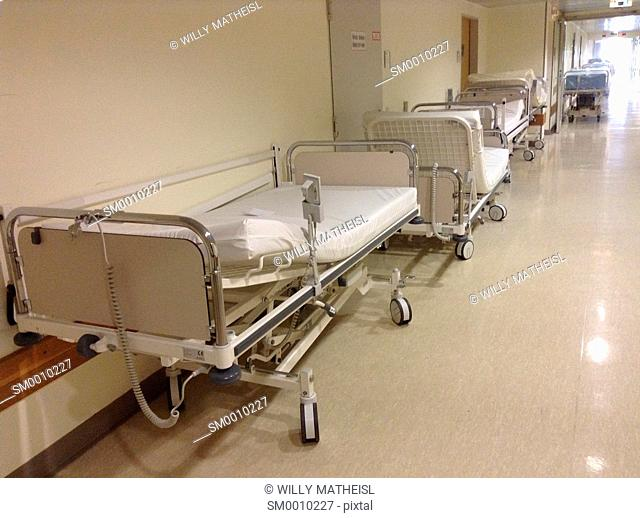 stored beds in hospital corridor