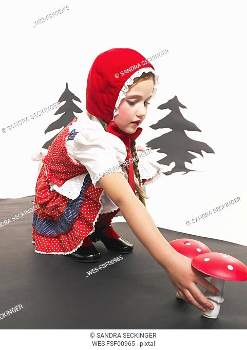 Portrait of little girl dressed up as Red Riding Hood