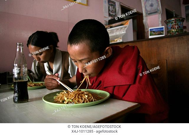 A young monk eats a meal at home  Buddhist monks are living in monastries in and around Kathmandu  Many are illegal refugees from Tibet but live quietly within...