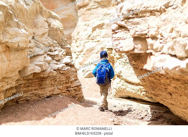 Boy exploring desert rock formations