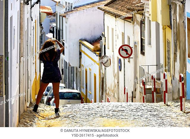 Europe, Portugal, Algarve, Western Algarve, Lagos, young female tourist taking pictures of traditional houses of old town