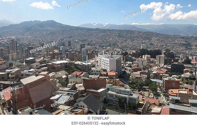 Cityscape of La Paz, Bolivia with Illimani Mountain rising in the background
