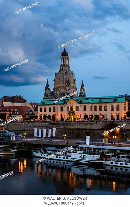 Germany, Saxony, Dresden, cityscape at dusk with paddlesteamers on River Elbe