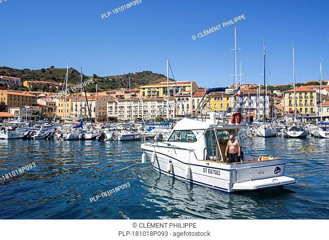 Motor boat entering marina / yacht basin at Port-Vendres, Mediterranean fishing port along the Côte Vermeille, Pyrénées-Orientales, France