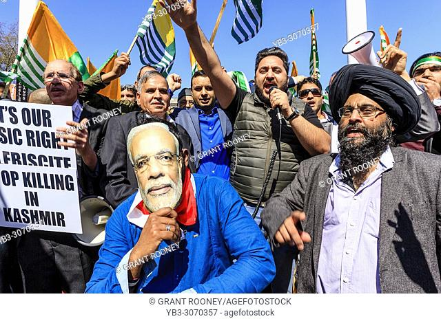 Hundreds of noisy Sikh and Kashmiri protesters demonstrate against Indian Prime Minister Modi in Parliament Square, London, Uk