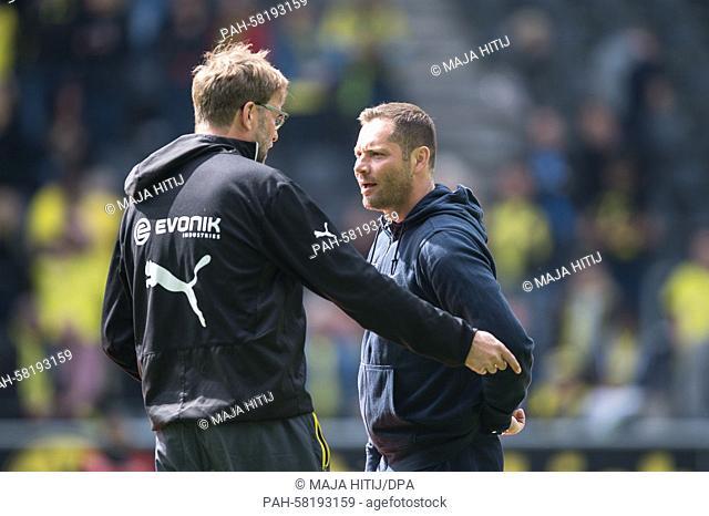 Dortmund coach Juergen Klopp and Hertha coach Pal Dardai converse before the German Bundesliga soccer match between Borussia Dortmund and Hertha BSC at the...