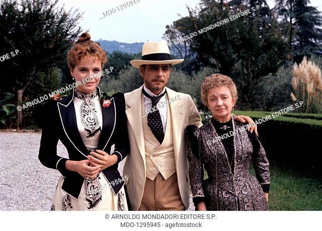 Laura Antonelli, Rina Morelli and Giancarlo Giannini in The Innocent. Italian actor Giancarlo Giannini embracing Italian actresses Laura Antonelli and Rina...