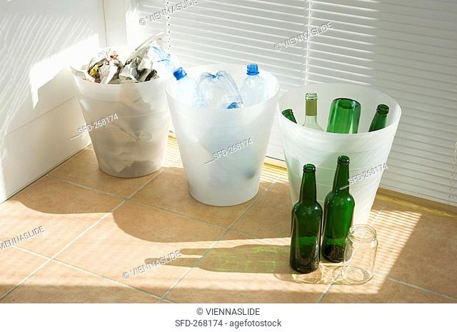 Separating rubbish: glass, plastic and the rest