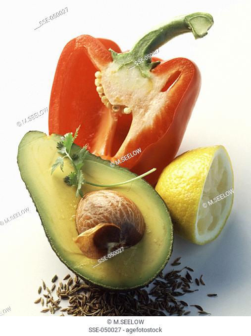 Halved avocado, red pepper and lemon
