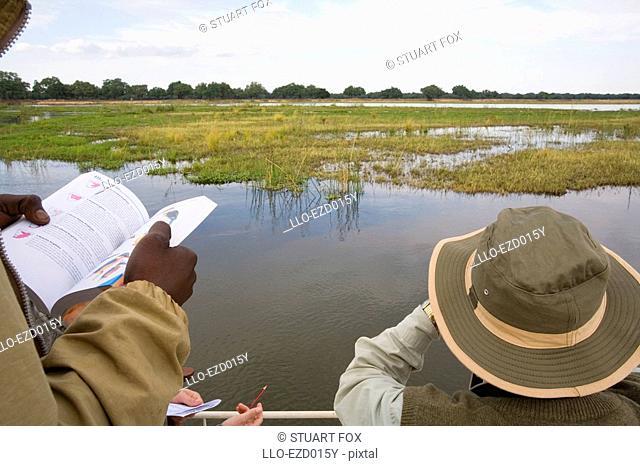 Tourists Birdwatching on the Zambezi River  Southern Province, Zambia