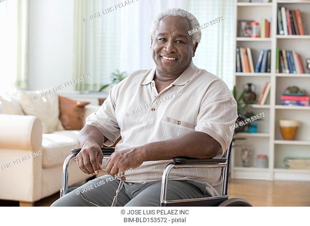 Older Black man smiling in wheelchair