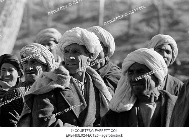 A group of men in Kabul Afghanistan during President Eisenhower's visit Dec. 1959., Photo by:Everett CollectionBSLOC-2011-6-88