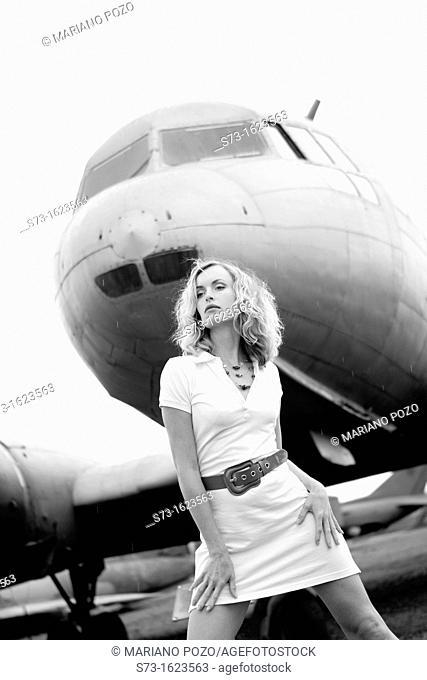 Sensual woman next to a plane