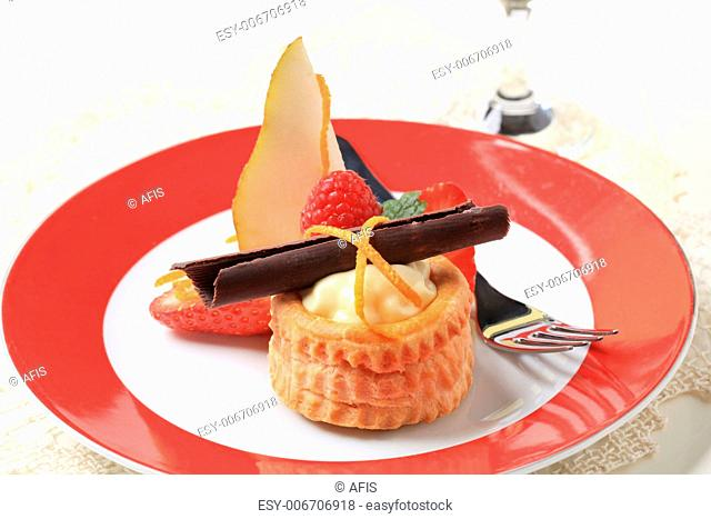 Cream filled puff pastry shell garnished with fresh fruit