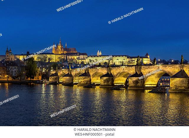 Czech Republic, Prague, Hradcany Castle and St Vitus Cathedral with Vltava River and Charles Bridge