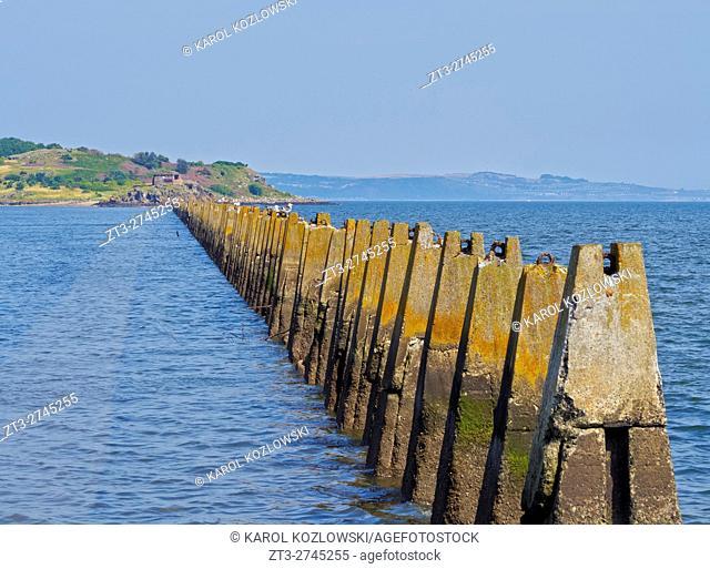 UK, Scotland, Lothian, Edinburgh Area, Cramond, Causeway and Pylons leading to the Cramond Island at high tide.