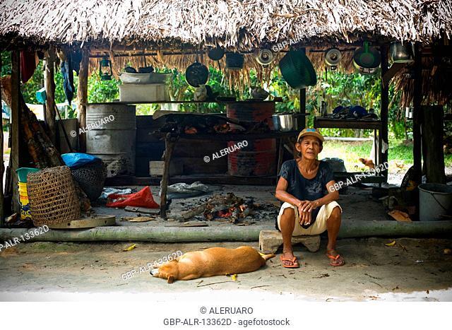 House, Seating woman, Barreirinha Community, Macaco River, Manaus, Amazônia, Amazonas, Brazil