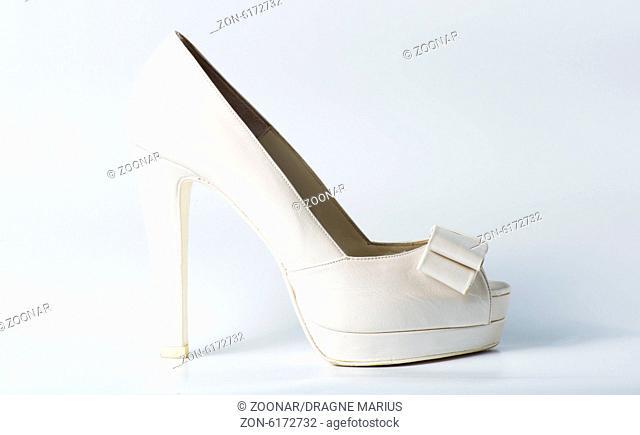 Woman white shoes on white
