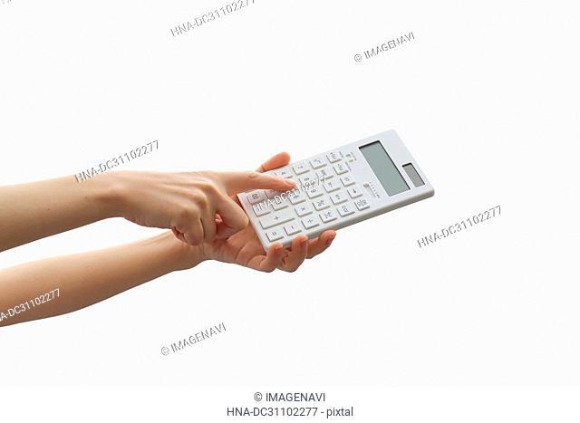 Woman Hand Holding Calculator