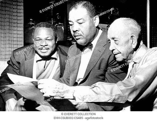 Conferring on the possibility of an Archie Moore vs. Gene Fuller. L-R: Moore, matchmaker Joe Lewis, and Moore's manager Jack 'Doc' Kearns