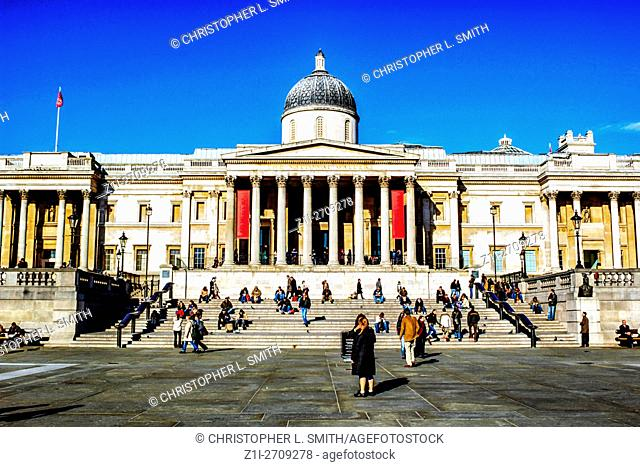 People outside the National Gallery in Trafalgar Square in London, UK