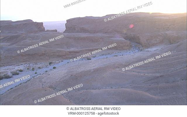 Aerial footage of Judea desert; Israel. Point of view flying along a canyon