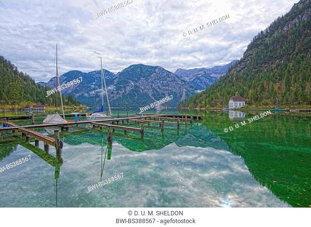 boat bridge on a clear lake in autumn, Plansee, Austria, Tyrol