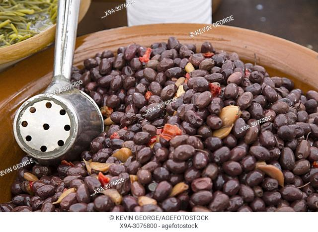 Bowl of Black Olives on Market Stall