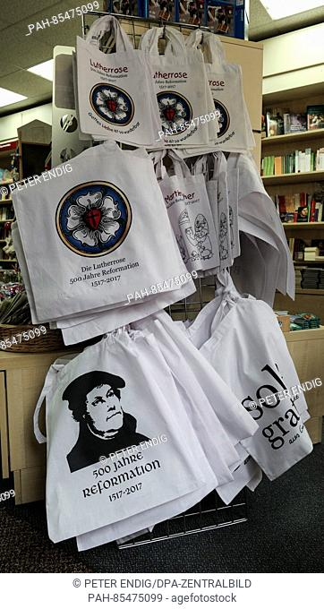 Shopping bags with a portrait of Luther, the Luther Rose and the writing '500 Jahre Reformation 1517-2017' are sold at a store in the Luther city Wittenberg