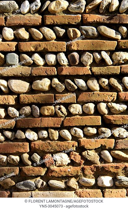 Structure of stones wall in southwest of France made with limestone and bricks