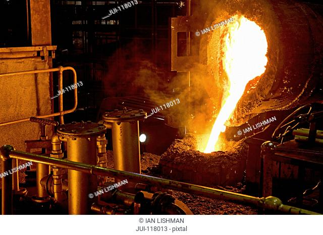 Molten Metal Is Poured Into Mold In Steel Foundry